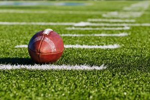 Football on Yardage Marker. Low Angle. Horizontial View